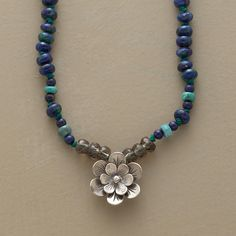 "GRANDIFLORA NECKLACE -- Our exclusive, double-petaled sterling silver flower charm poses amid smoky quartz rondelles on a necklace of azurite and turquoise. Hand strung on silk with a lobster clasp and extender chain. 17"" to 19""L."