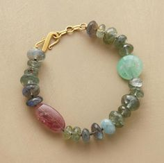 """Lena Skadegard makes chrysoprase and pink tourmaline the stars of her subtly sparkling bracelet of labradorite and moss aquamarine, highlighted with an 18kt matte gold S-hook clasp. Stones will vary in size and shape. 8""""L."""