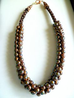Beaded Kumihimo necklace The Chameleon in copper bronze by The Beckoning Cat. Versatile necklace appears to change color / pick up different highlights depending on what color it is worn against...just like the reptile, $165.00