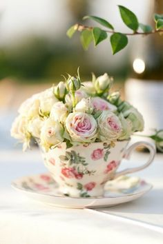 CENTERPIECE - Sweetheart roses arranged in teacups make a pretty statement. Place one at every place setting or place many along the center like a runner - cute For a tea party.
