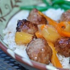 Prepared meatballs simmer in a slow cooker with a sauce made with canned pineapple in juice and green bell pepper for a dish that will be popular at any gathering.