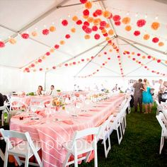 I love these colorful tissue paper poms that were used to decorate the ceiling of this reception tent.