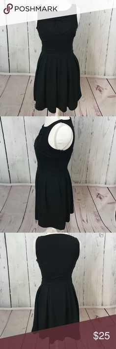 LC Lauren Conrad Black Bow Fit &Flare Dress Very good pre-owned condition,measurements taken flat: chest 17 inches, waist 14.5 inches,length from shoulder to bottom hem 35 inches LC Lauren Conrad Dresses
