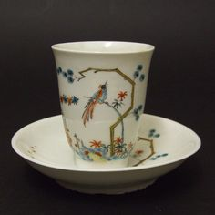 An Early 18th Century Meissen Bottger Porcelain Beaker and Saucer c.1715. Decorated in Holland in the Kakiemon Style c.1725. Provenance : The Helen Espir Collection of European Decorated Chinese Export Porcelain.