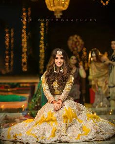 Full sleeved yellow lehenga with golden embroidery for that festive touch! Bridal Mehndi Dresses, Asian Bridal Dresses, Pakistani Formal Dresses, Pakistani Fashion Party Wear, Pakistani Wedding Outfits, Bridal Dress Design, Pakistani Wedding Dresses, Pakistani Dress Design, Bridal Outfits