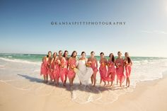 Bridesmaids in coral dresses look beautiful on the beach! Photography by Kansas Studios