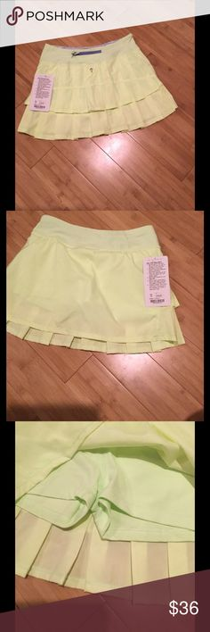 NWT Ivivva Set the Pace Skirt/skort youth 14 Brand new with tags, Ivivva tennis skort. Girls 14, similar in size to a lulu 4 petite. Ivivva is the youth line of lululemon. This is neon yellow, though the photos look lighter. Ivivva Shorts Skorts