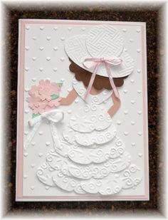 heart punch and layered the dress and then hand cut some details - like the arms and bodice. Her little hand-cut arms are a peachy color, as is her back, but it really doesn't show up in the picture very well. I used my new 'hearts' embossing folder (non SU) on whisper white, scalloped the bottom and layered it over some trim left over from a kit. The flowers are done with the boho blossom punch and a few tiny pearls were added.