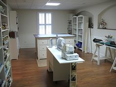 A sewing room of my own...with storage, sewing table, comfy chair, cutting table, ironing board, and TV. :)