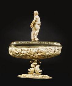 CIRCLE OF GEORG PFRÜNDT (CIRCA 1603-1663)  SOUTH GERMAN, 17TH CENTURY AND LATER  CUP WITH BATTLING SEA CREATURES AND ANDROMEDA narwhal and ivory mounted in silver gilt, the nude with inlay, with possibly associated ivory stem  overall: 26cm., 10¼in.