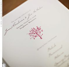 A red apple tree design on the programs was guests' first taste of the apple theme and added a touch of color to the simple stationery.