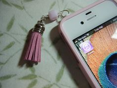 Cell Phone Dust Cap Plug Pink Alabaster Swarovski Cube Bead Silver Capped Faux Leather Tassel. $12.00, via Etsy.