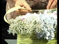 Floral arrangement trainer Eunice Teoh from Amtrol Floral Designing gives a few simple tips on floral arrangement.  In this episode, she is demonstrating how to create a dining table centrepiece with hydrangea.