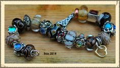 Glitters, there are three bead maker beads on here...first two glass from lock and the pumpkin. By Deborah Taylor
