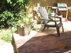 a deck made from 2/3 reclaimed free lumber.... and I did it by myself!   Just have to finish staining