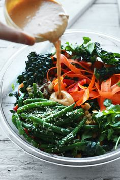 30-minute GINGERY Thai Kale Salad with TONS of veggies and a Cashew Dressing