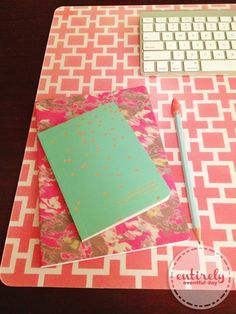 Super quick and easy way to create a custom desk pad. Cute way to decorate your home office!