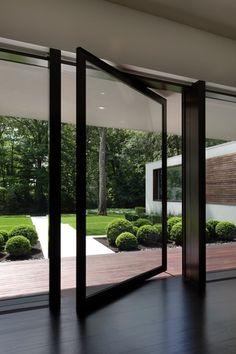 Modern Front Door with Ebony stain hardwood floors, Pivot doors