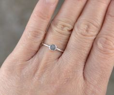 This raw diamond ring is handmade at my studio in England. The rough diamond featuring on this ring is in its natural form, uncut.  Material: raw diamond, sterling silver, find silver Color of the raw diamond: grey Weight of the raw diamond: 0.20ct Size of the setting: W5.1 x L4.8 x D3.4 mm Width of the band: about 1.4mm Size of the ring: US size 5 ( UK size J) - US size 9.25 (UK size S). Any other size, please contact me to confirm.  The postage is the same regardless of how many items you…