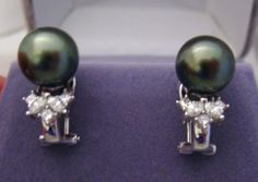 Black Tahitian Pearl, 3/4 ct natural Diamonds and 18k solid gold.  Auction ends soon.  Winning bid at $299 right now.  These retail for 1500 and up!!