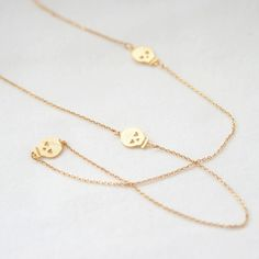 Gold Long Necklace with three skulls by laonato on Etsy, $20.00
