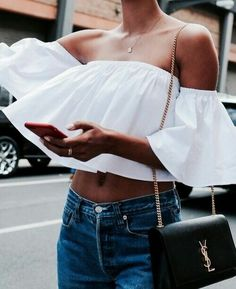 White top and denim jeans for spring street style.