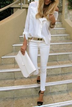 all white, black strappy heels, and gold belt
