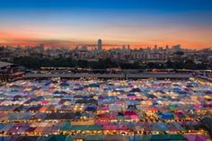 By Jatinder Heer. Sunset over Bangkok's Rod Fei night market. Photography Competitions, Bruges, Seattle Skyline, Bangkok, City Photo, Cool Art, Travel Photography, In This Moment, Sunset