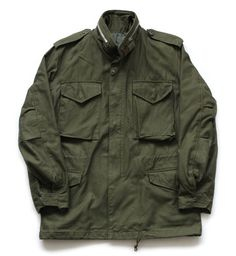 The Real McCoy's  M-65 Jacket  $850.00    This M-65 is an updated release by McCoys with extra detail added including webbed cuffs and a sewn in front zipper cover. The OG107 cloth has also been reexamined to bring it even closer to the deadstock original.    • 100% cotton sateen outer  • Lining is 50% cotton and 50% polyester  • Made in Japan