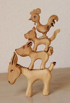 wooden hand crafted stacking toy based on the popular Musicians of Bremen Animal Sculptures, Lion Sculpture, Wooden Hand, Wood Toys, Pyrography, Toddler Toys, Wood Carving, Art For Kids, Fairy Tales