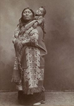 An old photograph of a Kiowa Mother and Baby Son.