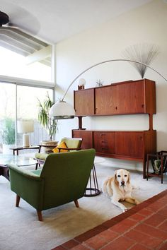 We can come very close to recreating this now, with the items we have: coffee table, red chair, Hipsteria wooden shelving units against the wall. would work brilliantly in what is now the living room -- chairs facing outdoors, as here.