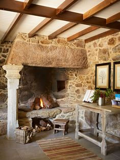 One could imagine spending countless dreamy, quiet hours in this country hotel – it's truly the epitome of blissful, traditional interior design. Stone Wall Design, Rustic Fireplaces, Traditional Interior, Fireplace Design, Open Fireplace, Fireplace Ideas, Cottage Fireplace, Fireplace Stone, Stone Houses