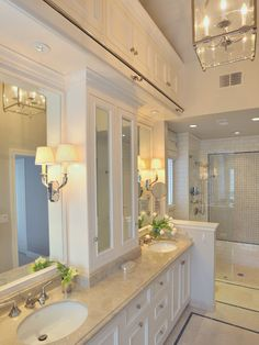 I love this bathroom... all except the rod above the mirrors. Cannot put my finger on what that would be used for?