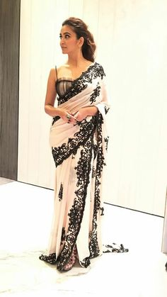 Bustier blouse in black with mini fringes nad spaghetti strap Pink beige sare with heavy lace border in black Kriti Kharbanda Saree Gown, Sari Dress, The Dress, Indian Blouse, Indian Sarees, Indian Dresses, Indian Outfits, Modern Saree, Stylish Sarees