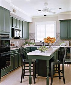 Narrow kitchen island with seating on one end. Galley Kitchen Island, Black Kitchen Cabinets, Green Cabinets, Kitchen Island With Seating, Green Kitchen, Painting Kitchen Cabinets, Black Kitchens, New Kitchen, White Cabinets