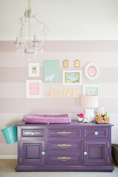 Painted Purple Dresser with Sea Mist Blue and Gold Knobs. Fun nursery via Project Nursery!