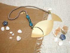 Brass Fish necklace by Riddhika Jesrani Jewelry. Made from: Brass, shell pearls, crystals and glass. Colors: lilac, blues and gold.  www.facebook.com/riddhikajesranijewelry