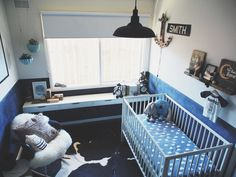 "We love that there are so many ""recycled"" pieces in this white and blue nursery! #nursery #recycle"