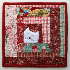 I love little projects! In our busy lives, there's always time to quilt something small. I also love log cabin quilt blocks. I have never designed anything using this simple block until now... enter t