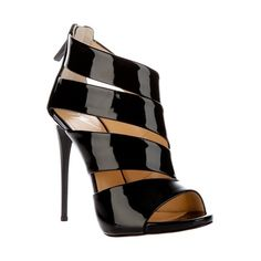 afeeefde69f2 Black patent leather sandals from Giuseppe Zanotti featuring a diagonal  stripe cut out design to one side