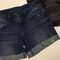 Distressed Cuffed Denim Shorts Worn but in great condition. No stains or flaws. Stretch denim shorts. Can be worn a little longer or rolled a second time. No Paypal. No trades. No offers will be considered unless you use the make me an offer feature.     Please follow  Instagram: BossyJoc3y  Blog: www.bossyjocey.com delia's Jeans