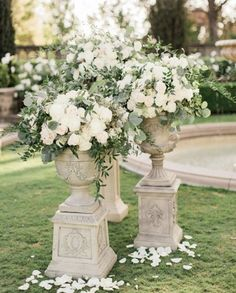 I love this. The greenery, flowers, and even the pedestals.