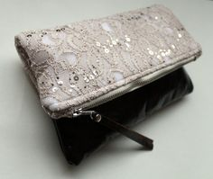 Lace and leather fold over clutch, sequin lace clutch. $48.00, via Etsy.