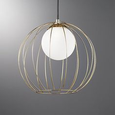 Drawing inspiration from vintage globe birdcages, Mermelada Estudio's modern pendant delicately encloses a single frosted glass globe. Open framework in warm brass finish is a minimalist dream. Globe Pendant Light, Modern Pendant Light, Modern Chandelier, Chandeliers, Chandelier Ideas, Home Lighting, Pendant Lighting, Lighting Ideas, Kitchen Lighting