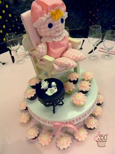 Childhood revisited with a doll, fondant tea set and pedal cupcake centerpiece made by 350 Classic Bakeshop in Mamaroneck , NY