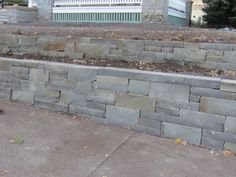 Bluestone Retaining Walls | Tiering or dividing a wall into two or more walls reduces the scale ...