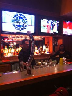 Christian Delpech showing off some bartending tricks at Applebee's 50th and Broadway