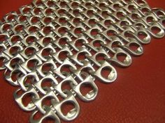 DIY chainmaille (chain mail) from linked pop (soda / beer) can tabs - use for purses, costumes, etc.! Instructable tutorial.