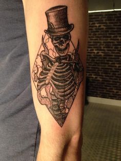 Skeleton in a diamond tattoo